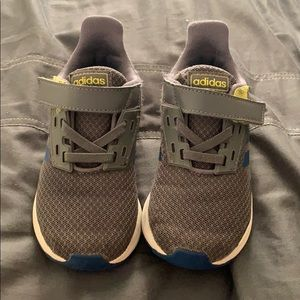 Grey and navy adidas tennis shoes
